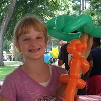 Girl celebrating summer with balloon animals